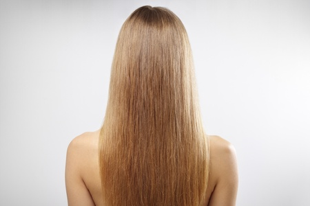 hair back: Girl with beautiful straight hair on a gray background