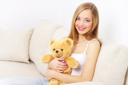 Attractive girl with a teddy bear photo