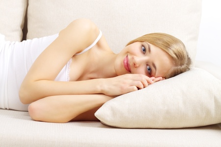 Beautiful girl resting on sofa on a light background Stock Photo - 12235333