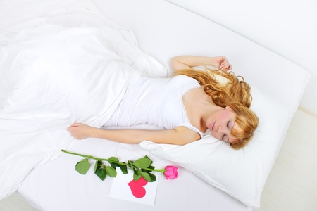 Cute young girl sleeping on the bed photo