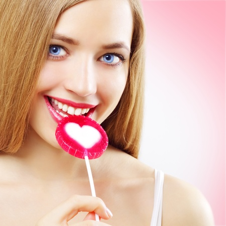 Lollipop. Girl with lollipop on a pink background Stock Photo