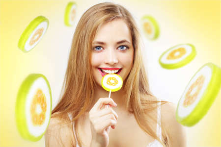 sexy lollipop: Lollipop. Girl with lollipop on a yellow background