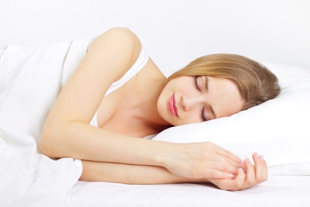 Sleeping Girl on the bed  on light background Stock Photo - 12589387
