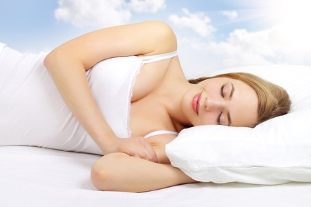 sleeping rooms: Sleeping Girl on the bed  on light background