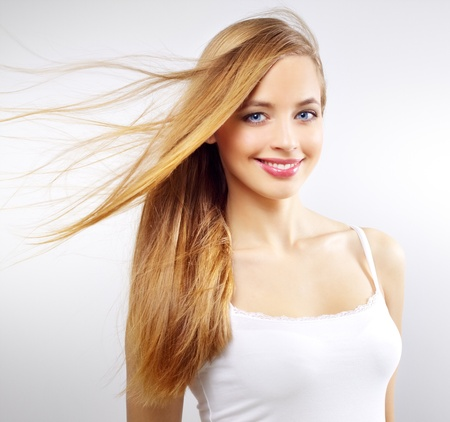Pretty girl with long hair on a gray background Stock Photo - 12589462
