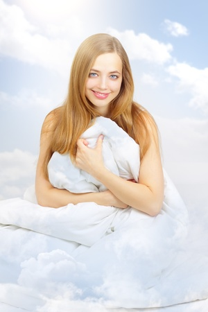 bedding: beautiful girl in the clouds on a light background