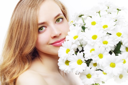 beautiful girl with white chrysanthemum on a light background photo