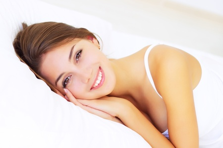 smiling girl lying on the bed Stock Photo