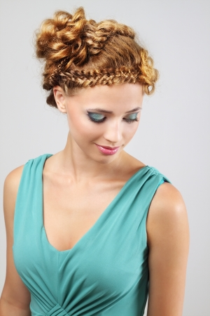 Woman with beautiful hairstyle on light background photo