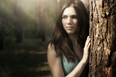 beautiful woman in nature scenery  dark background