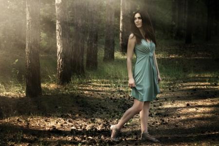 beautiful woman in nature scenery  dark background photo