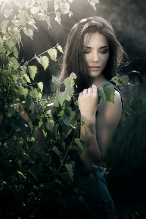 beautiful woman in nature scenery  dark background photo