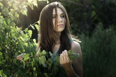 beautiful girl in fairy forest  dark background Stock Photo