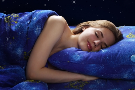 Sleeping Girl at night on dark background