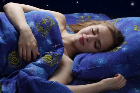 Sleeping Girl at night on dark background photo