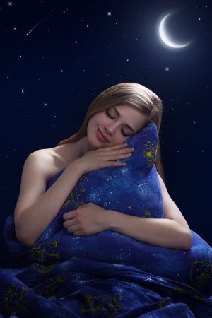 Sleeping Girl on dark background photo