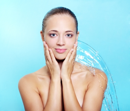 sexy shower: Beautiful girl and stream of water on a blue background