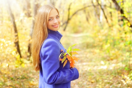 Portrait of a beautiful girl in autumn forest photo