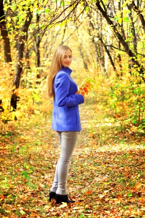 sexy teen girl: Portrait of a beautiful girl in autumn forest Stock Photo