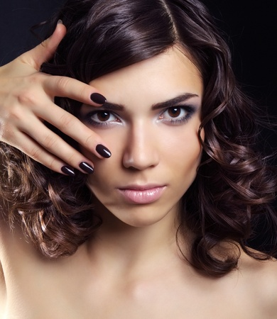 Closeup portrait of a beautiful young woman with makeup Stock Photo - 15691569