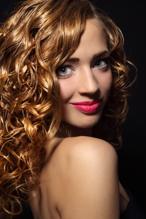 Portrait of a beautiful girl with curly hair Stock Photo - 16058645