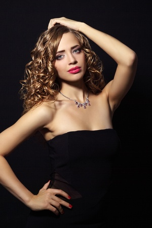 Portrait of a beautiful fashion woman on black background photo