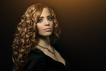 Portrait of a beautiful girl with curly hair photo