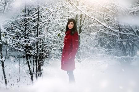 Beautiful elegant woman in red coat  winter nature photo