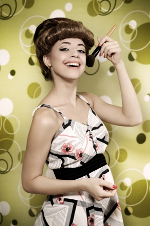 Retro style  Beautiful girl with makeup brush photo