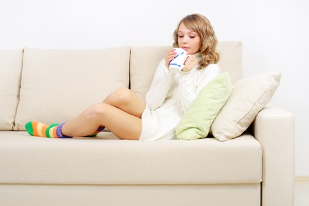 girl drinking tea while relaxed on the couch Stock Photo - 16619537