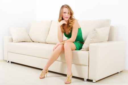 Elegant girl on sofa  light background photo