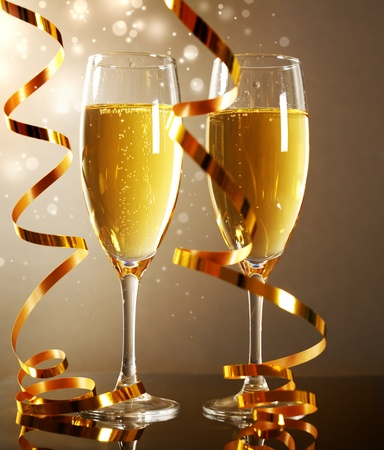 Glasses of champagne on dark background photo