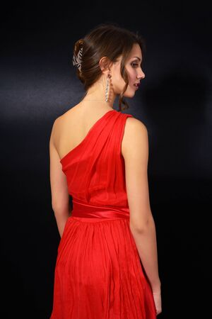 elegant young woman in red dress on black background Stock Photo - 16792971