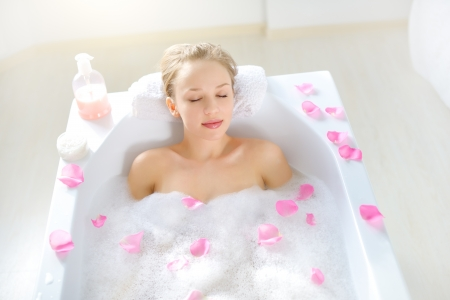 lying in bathtub: Attractive girl relaxing in bath