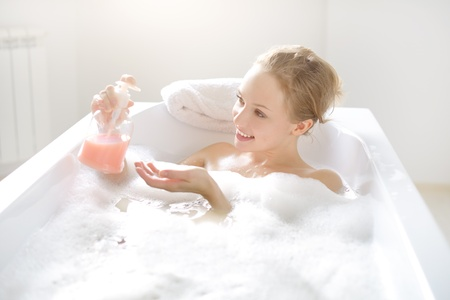 young girl bath: Girl with liquid soap in the bath Stock Photo