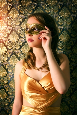 carnival mask: Beautiful girl in carnival mask on�dark background