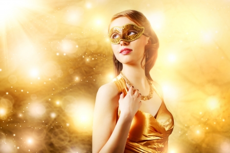 Beautiful girl in carnival mask on�dark background photo