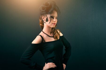 Beautiful girl in a black dress on dark background Stock Photo - 17858728