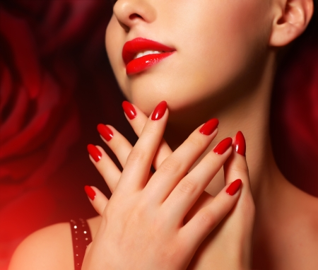red lips: Makeup and manicure  Girl with beautiful make-up Stock Photo