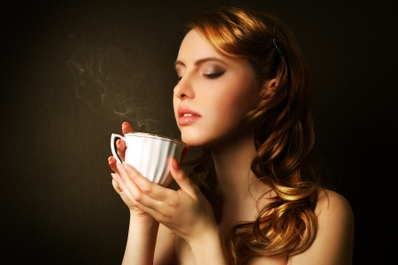 An attractive girl with a cup of coffee Stock Photo
