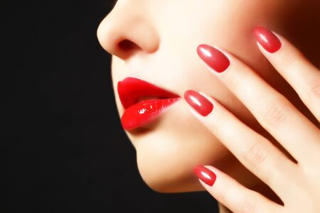 red lip: Makeup and manicure  Girl with beautiful make-up Stock Photo