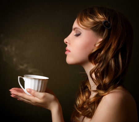 An attractive girl with a cup of coffee photo