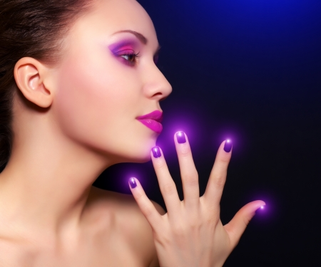 Makeup and manicure  black background photo