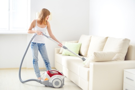 vacuum: Attractive girl with vacuum cleaner