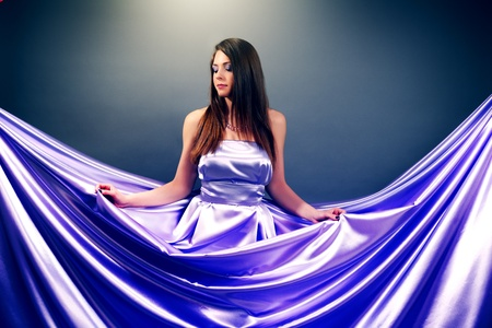 Beautiful girl in violet long dress photo
