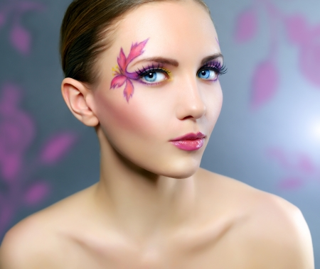 faceart: Girl with beautiful makeup  blue background
