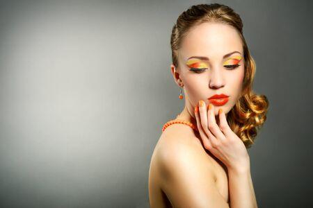 Sensual woman with beautiful make-up on gray background photo