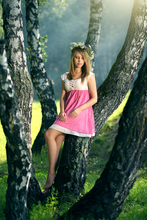 beautiful girl in fairy forest. light background Stock Photo
