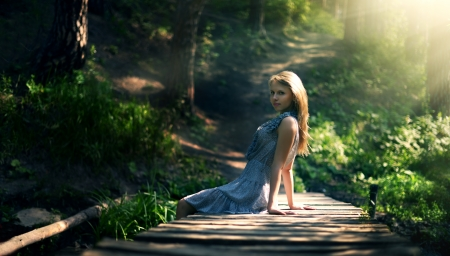 wood nymph: beautiful girl in fairy forest dark. background Stock Photo