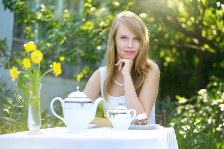woman drinking tea: Beautiful woman drinking tea. Outdoors Stock Photo